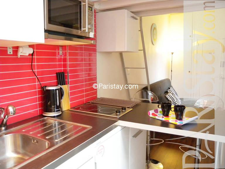 Mezzanine Area furnished studio apartment paris place des vosges 75004 paris